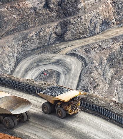 Mining trucks driving around the