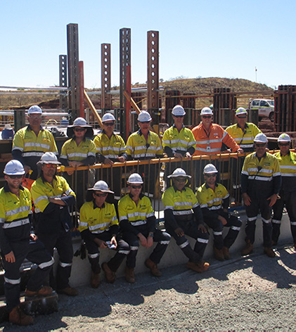 A team of workers in hi-vis at a mine site