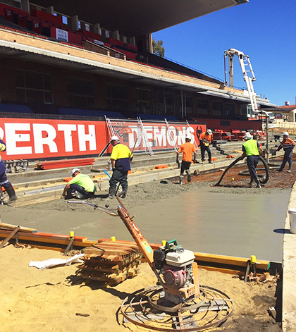 An image of construction workers and manual labourers concreating at a perth sports stadium